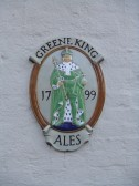 'Greene King' plaque on the wall at the Coach House Public House in St Neots High Street in November 2012