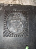 Little Paxton Church - detail of a shield on a gravestone