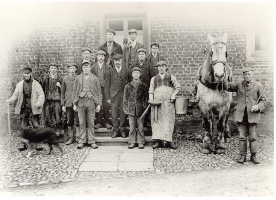 Estate workers outside Toseland Manor, about 1900.