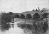 A boy fishing near 'Five Arches' Bridge on the River Great Ouse, Eaton Socon, about 1900