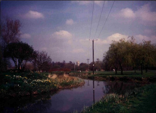 Riverside Park, Eaton Ford, view along the river looking north, St Neots parish church tower in sight, in March 1988
