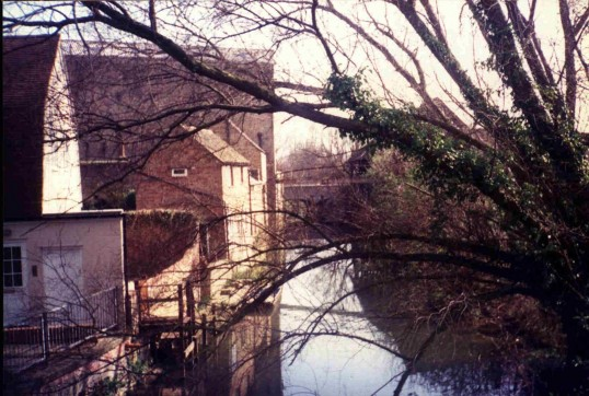 Hen Brook, with private house and industrial buildings, St Neots, in March 1988