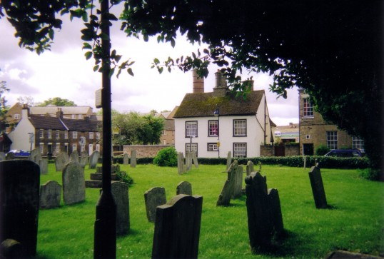 St Neots, St Mary's Churchyard, with Brook Street houses in background in July 2007