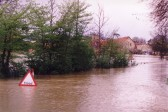 Flooding of the River Great Ouse at Mill Lane, Little Paxton, in April 1998, with the Paper Mill in the background