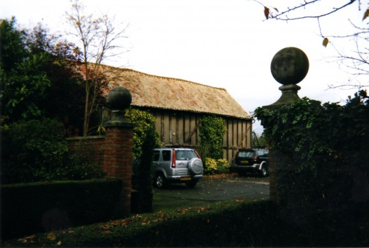 Looking through the gateway of Crosshall Manor, Eaton Ford, in 2007, to see the old barn.