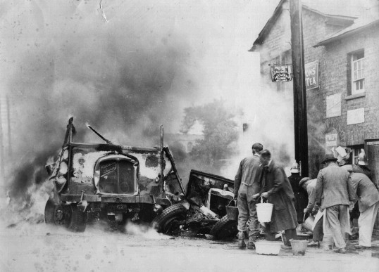 Road accident and fire, with a lorry and car, outside 119 Great North Rd, Eaton Socon in 1935.