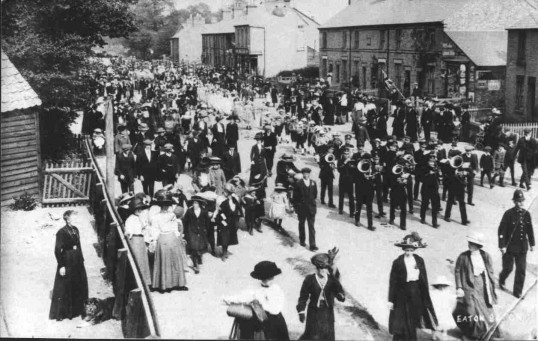 Procession through Eaton Ford along St Neots Rd - May Day or Jubilee celebrations, about 1910
