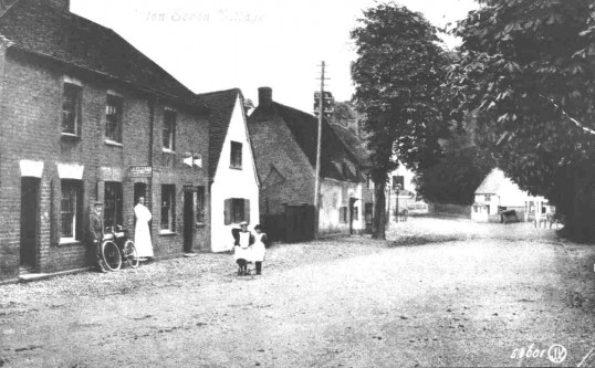 Children standing in the road outside the Waggon and Horses and Old Sun public houses in Eaton Socon, about 1910