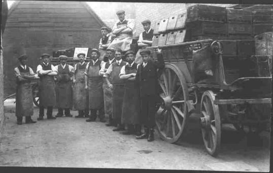 Jordan & Addington workers with cart, around 1910.