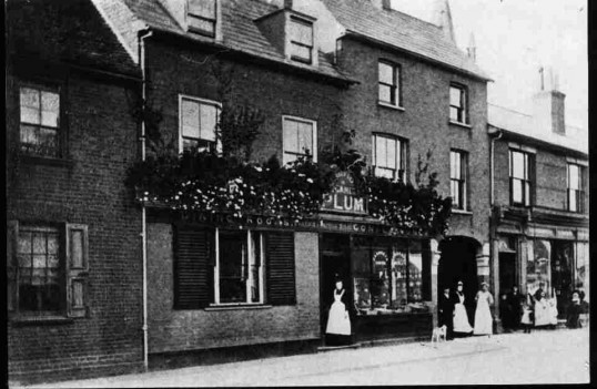 Plum's Cafe in St Neots High Street, with aproned staff outside - 1890-1910.