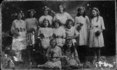 St.Neots Wesleyan Band of Hope. a group of 11 girls with white dresses, floral head dresses and bouquets. c1920