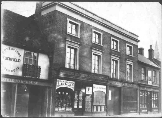 St. Neots High St North side around 1900 - 4 shops, Tuckfield Boot & Shoe; Consumers Tea Co; J Bettle Watch & J; Dalzell groceries