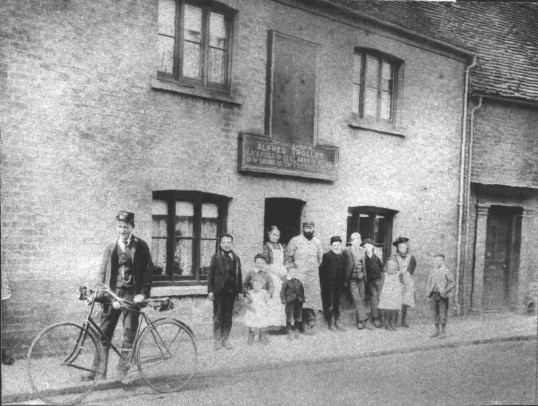 The Village Blacksmith St Mary's St Eynesbury, around 1910. Trolley family. 'Joss' Bass PO Messenger boy later prominent man & Racing Cyclist.