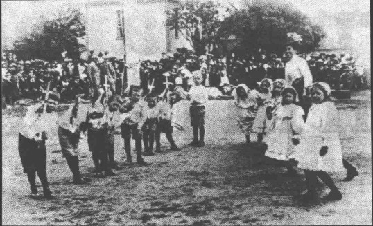 Children performing on Eaton Socon Village Green at its annual May Day Celebrations, 1900-1910