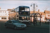 Stagecoach bus for Cambridge in St Neots Market Square in 2007. Cross Keys in  background