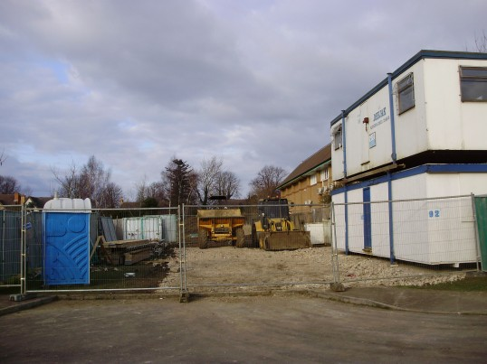 View into the construction site for the Eatons Community Centre at the rear of the Co-operative Food Store showing the offices, a Portaloo and machinery, in February 2009. (P Ibbett)