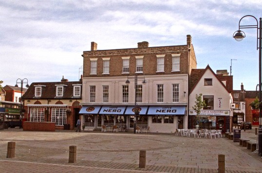 Golden Ball, Caffe Nero and Market Cafe on the east side of the Market Square, St. Neots in March 2007,