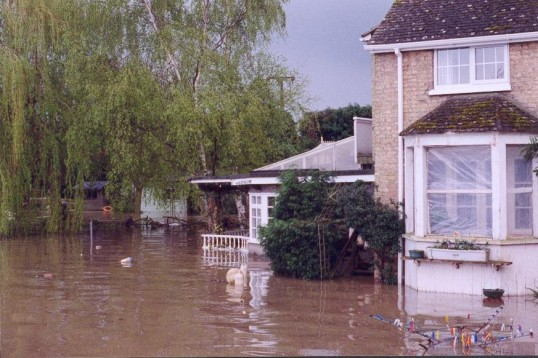 The garden at Mill House Little Paxton in flood, in 1997 (note water level on washing line!)
