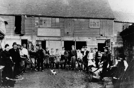 Ibbett Family and workers at Ibbetts Yard in South Street, St Neots, around 1900 (P.Ibbett)