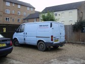 Egg Van in Cemetery Road, St Neots in January 2011, and Tebbutts former workshop behind (P.Ibbett)