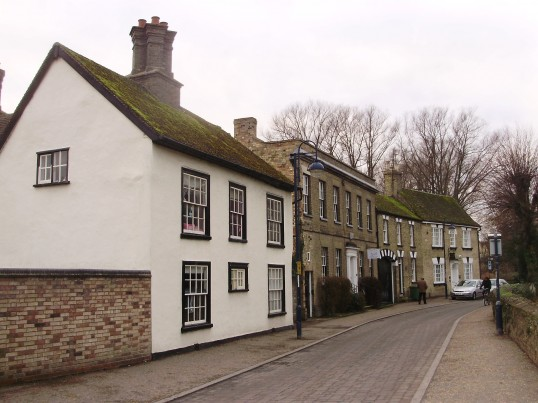 View along Brook Street looking west with former painted foremans house next to business yard in January 2011 (P.Ibbett)