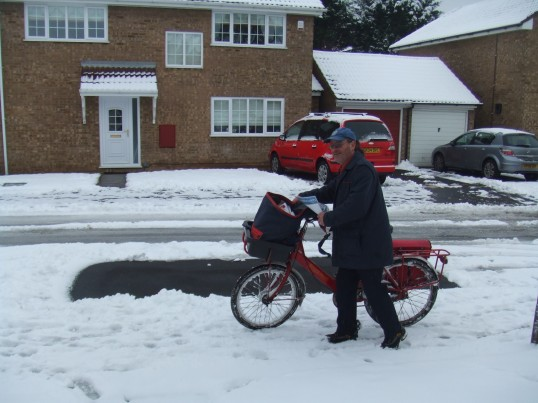 David, the postman and his bike in Eaton Socon in January 2013