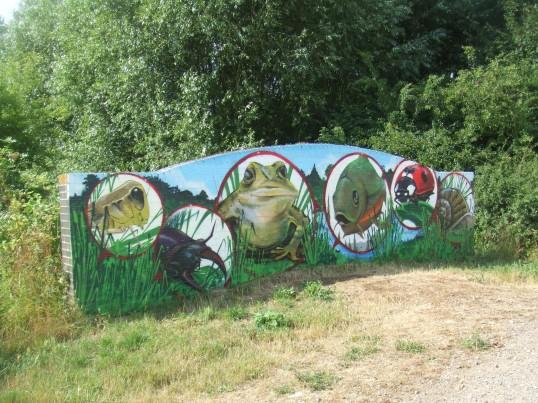Wildlife mural on a bridge in Barford Pocket Park in July 2013