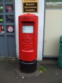 A red post box outside the Post Office in Eaton Socon after it was painted ! - October 19th 2013