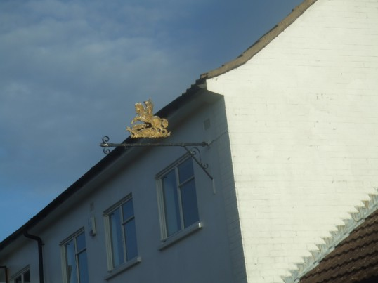 The Plough, Eynesbury - the Manns Brewery sign figure close up - January 13th 2014