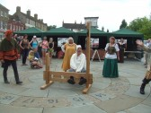 Mediaeval Fayre, a man in the stocks on St Neots Market Square - 27th July 2013