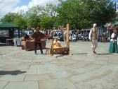 Mediaeval Fayre, a re-enactor in the stocks on St Neots Market Square - 27th July 2013