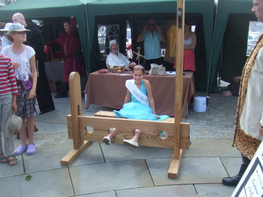 Mediaeval Fayre, the Eatons May Princess in the stocks on St Neots Market Square - 27th July 2013