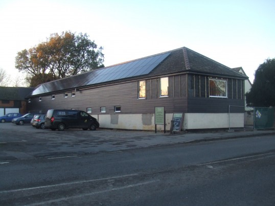The former Soloprint building has new windows, solar panels and is now being clad in wood - January 2014