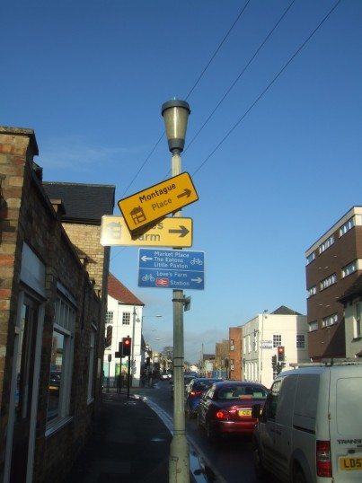 Montague Place road sign falling down, in Church Street - January 2014