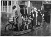 1947 Floods - Tomson and Lendrum staff leaving by boat in the Market Square.