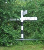 An old style signpost at Honeydon, in Eaton Socon Parish, newly painted