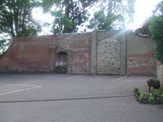 The back wall of the Old Sun yard in Eaton Socon - cleared of all its ivy - 10th June 2014