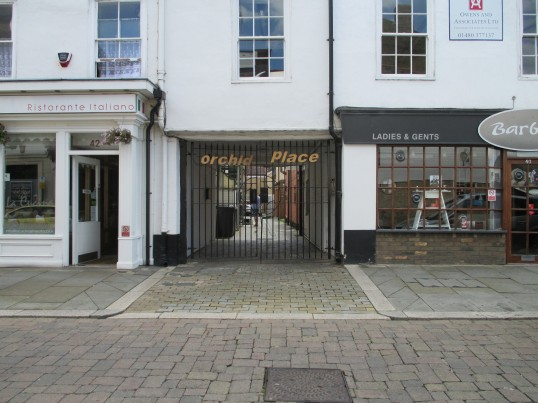 Orchid Place gates in the Market Square - housing down the yard between a restaurant and the Barbers -28th July 2014