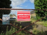 Arson Watch sign in Brook Street - on the gates of an empty piece of land - 19th August 2014