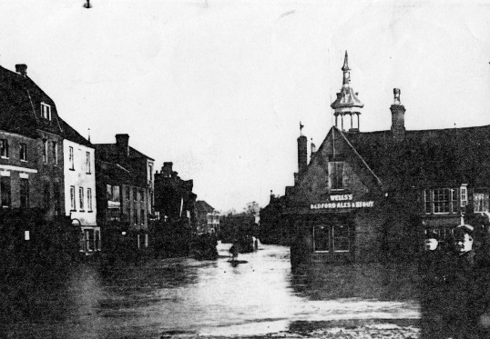 Floods in St Neots Market Square in 1912 - looking towards the Golden Ball