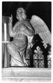 Close up view of a carved wooden angel seen in Eaton Socon Church - carved between 1930-1932.