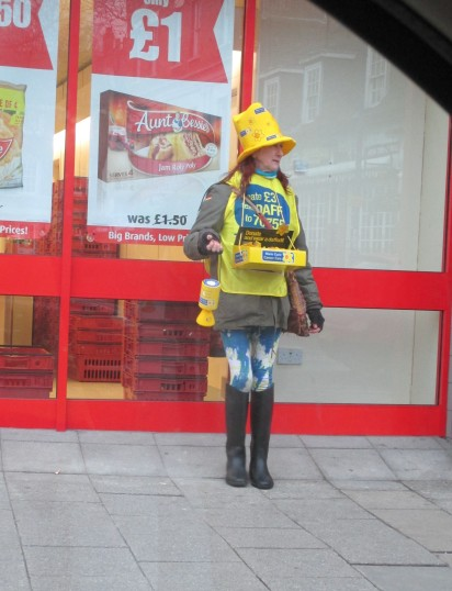 A lady dressed as a daffodil raising money for Marie Curie Cancer Care on 13th Feb 2015