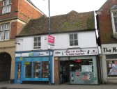 Cash and Cheque Express and Ouse Off Licence building up for auction, in St Neots High Street - 12th March 2015