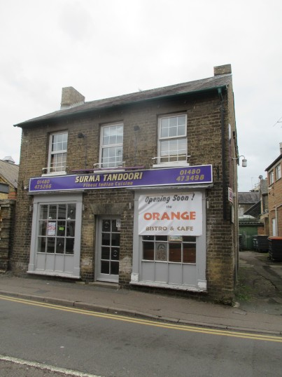 Former Surma Tandoori shop now has a sign indicating that it will soon be an 'Orange Bistro and Cafe' - 9th June 2015