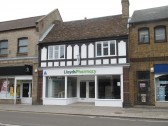 The new Lloyds Pharmacy is being fitted out - between Superdrug and Boots in St Neots High Street - 30th August 2015