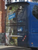 X5 bus with a scene on the back advertising Cambridge