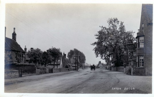 Great North Road, Eaton Socon with Ye Old White Horse, Goodes machinists and other cottages - looking south - 1920s