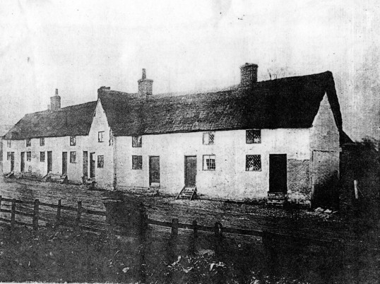 Cambridge Street - a group of timber framed thatched cottages - date and site unknown