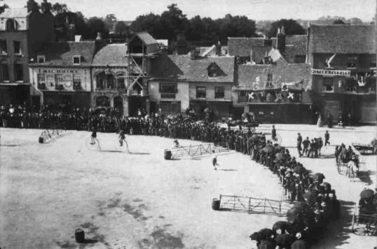 Cycle racing on the Market Square - possibly around 1900