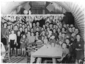 Stetchworth W.I. giving a party for the village children to celebrate the ending of the war in a mission hut in